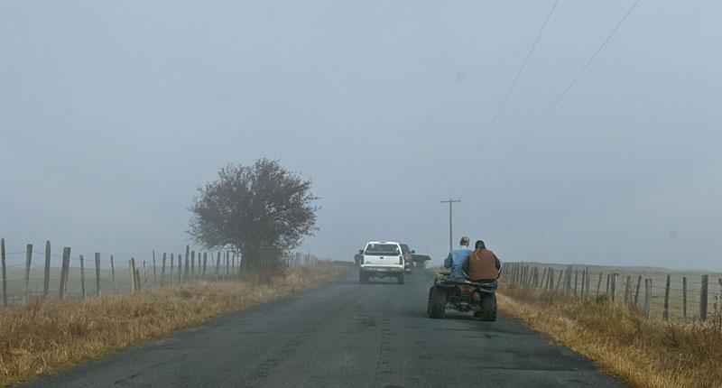 ATV, truck on road