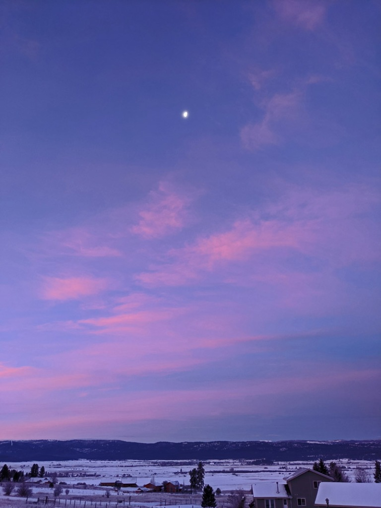 moon setting in lavender sky