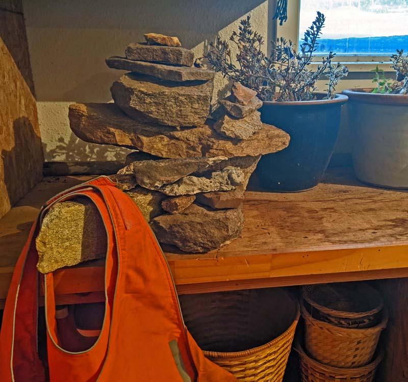 stack of rocks on table, orange vests
