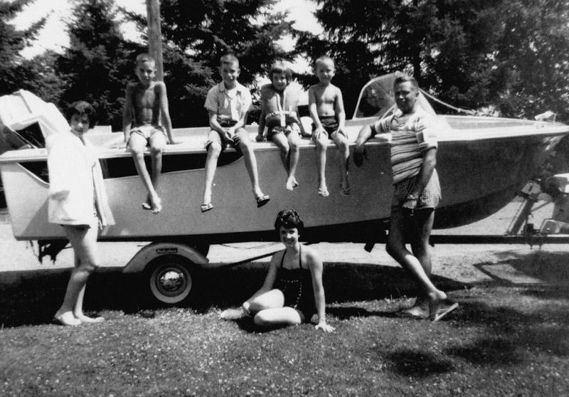 family next to ski boat