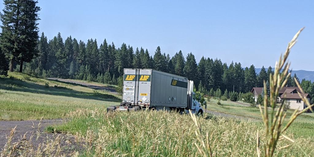 Semi-truck departing house