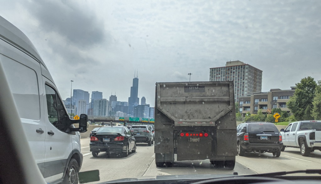 Four lanes of traffic through downtown Chicago on a Saturday morning.